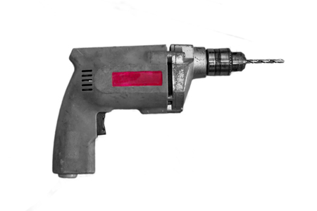Drill Machine with bit and head on white surface Stock Photo