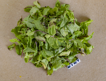 Text message along side of mint leaves pile Stock Photo