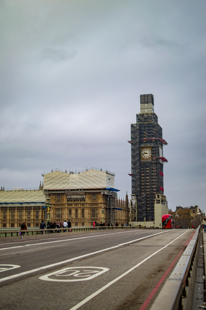 Big ben repair and westminster bridge with parliament building on the other side of london