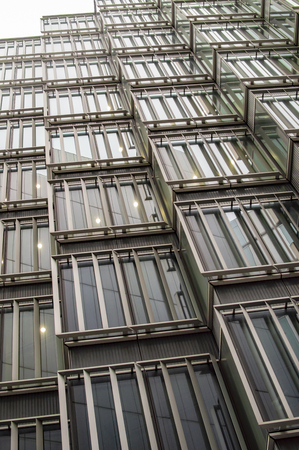 Skyscrapper windows in london and going towards the sky with bars and glasses