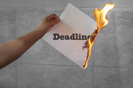 Burn deadline concept with paper and burning text Stock Photo