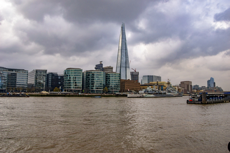 London skyline on the river thames with shards on the banks in uk