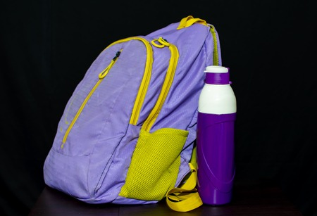 School bag and bottle for back to school concept with group