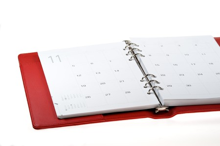 Rad leather notebook on a white background Stock Photo - 7948657