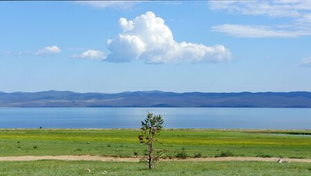 Beautiful summer landscape, light white clouds in the sky over the sea. Banco de Imagens