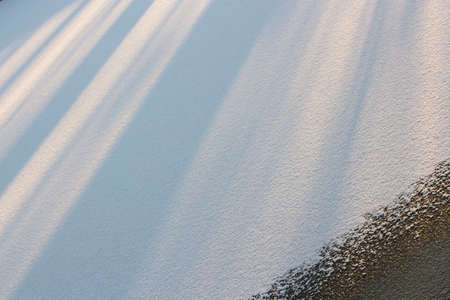 The geometric pattern consisting of snow field and sunlight.