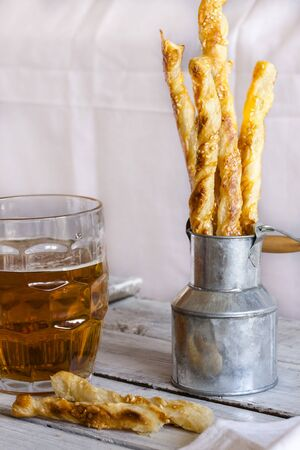 sesame cracker: Cheese stick cracker with sesame seeds and beer