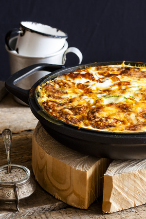 casserole of rice, vegetables, cheese and zucchini