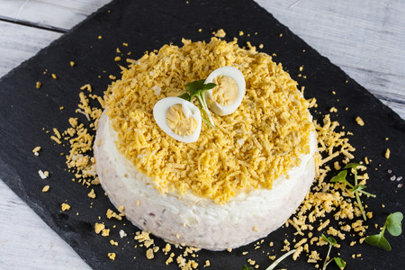 Mimosa salad with fish, eggs and cheese