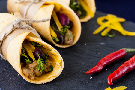 burrito: Burrito with meat, beans and bell pepper