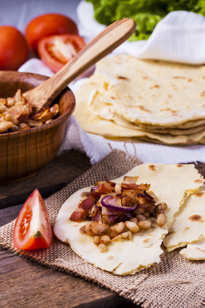 yellow corn: corn tortilla with bacon, beans and onions Stock Photo