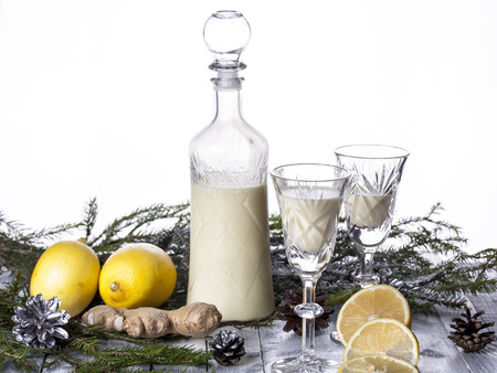 liqueur: cream liqueur with lemon and ginger on a white background Stock Photo