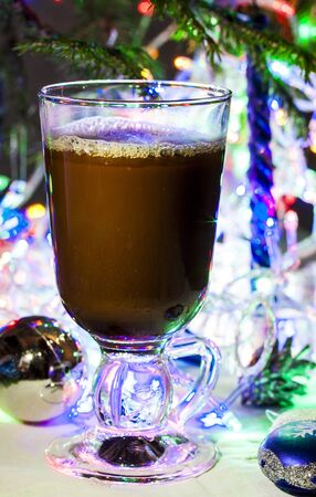 tall glass: hot chocolate in a tall glass on the Christmas garlands Stock Photo