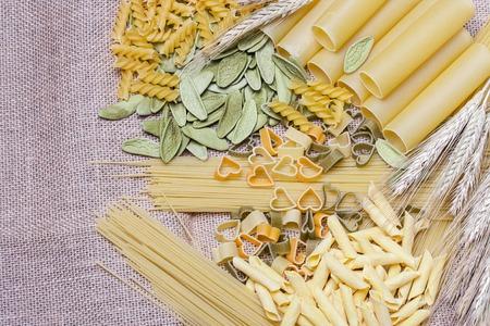 maccheroni: Variety of types and shapes of Italian pasta. Dry pasta background Stock Photo