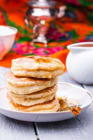 buckthorn: a stack of hot pancakes with buckthorn syrup Stock Photo