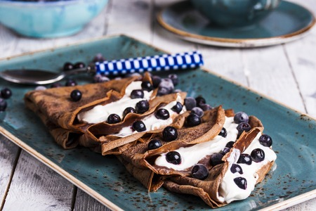 chocolate crepes with cream cheese and blueberries for Breakfast Reklamní fotografie
