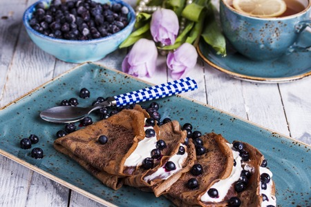 cream cheese: chocolate crepes with cream cheese and blueberries for Breakfast Stock Photo