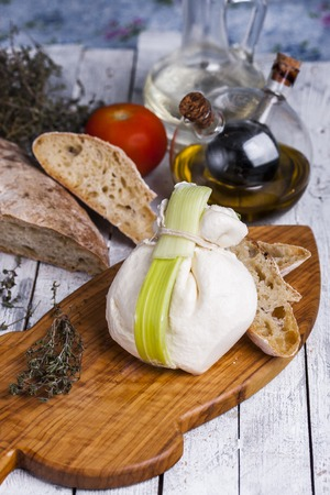 stracciatella: fresh Italian cheese burrata mozzarella with ciabatta