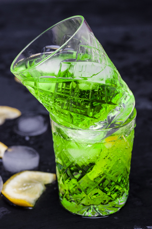 tarragon: lemonade from lemon and tarragon on black background Stock Photo