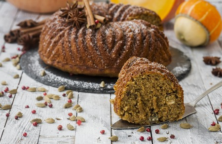 homemade cake with pumpkin, seeds and spices on wooden background Stock Photo