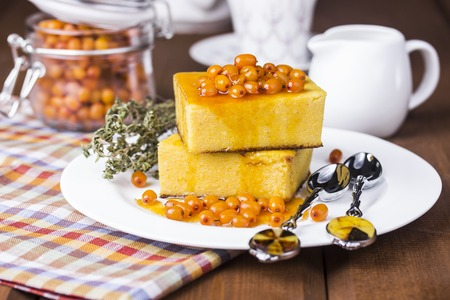 cottage cheese casserole with pumpkin and sea-buckthorn sauce Stock Photo