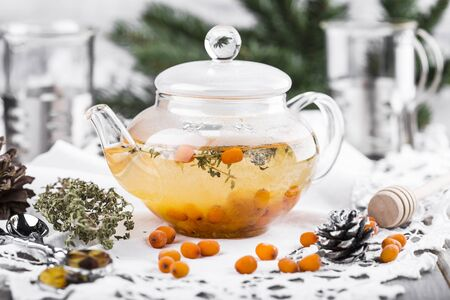 tea with sea-buckthorn berries, cloudberries and honey Stock Photo