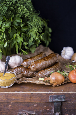 Homemade sausage of beef and venison in a rustic style
