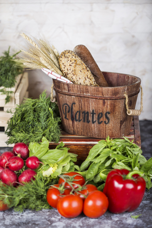 basket with bread and vegetables Stock Photo