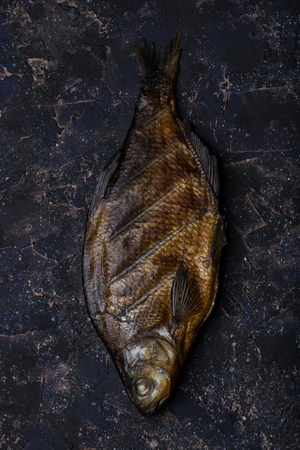 spice: smoked river fish on a dark background