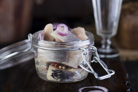 Marinated herring in a jar with onion