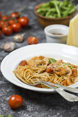 Spaghetti with shrimps and tomato sauce Stock Photo