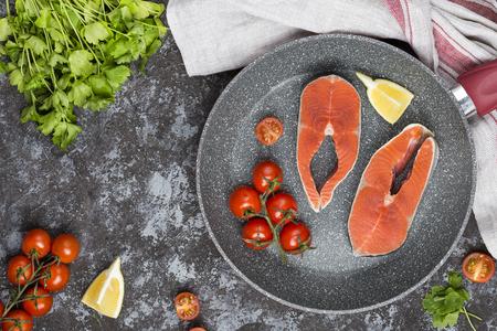 raw salmon steak with herbs, parsley and lemon Stock Photo