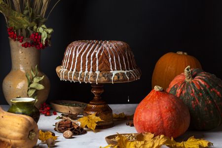 homemade pumpkin bundt cake with creamy frosting