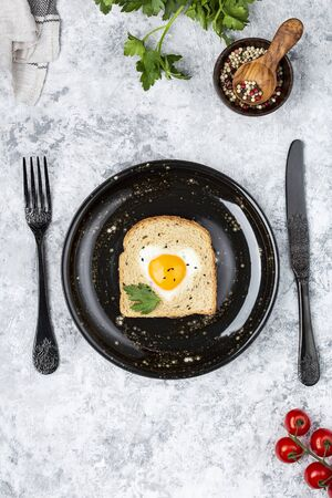 heart shaped cooked egg on a slice of toast