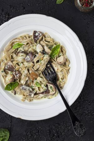homemade pasta tagliatelle with mushrooms, pesto sauce and cream