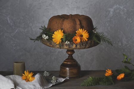 Bundt cake with pumpkin on rustic table