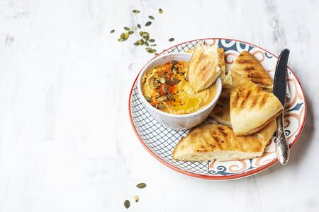 chickpeas hummus with olive oil and smoked paprika