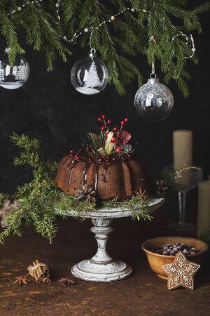 Pumpkin cake with chocolate glaze on rustic background Reklamní fotografie