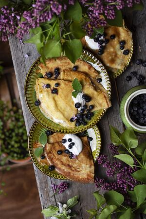 Breakfast Thin pancakes with blueberries and sour cream