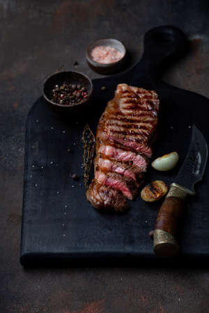Sliced grilled beef barbecue Striploin steak with thyme Reklamní fotografie