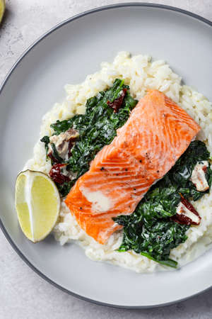 Salmon fillet with rice and spinach garnish
