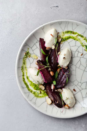 baked beetroot and cream cheese salad with nuts and pesto sauce Reklamní fotografie