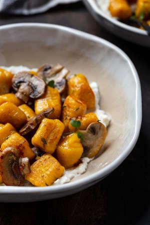 homemade pasta pumpkin gnocchi with mushroom sauce and ricotta Reklamní fotografie