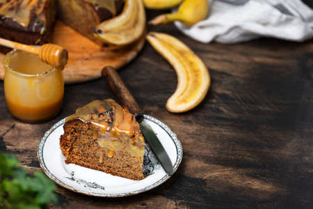 Upside down banana cake with caramel on a wooden table Stock Photo