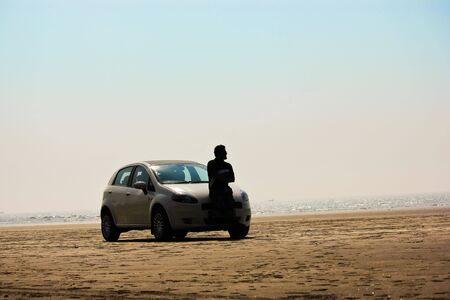 A car parked at a secluded beach