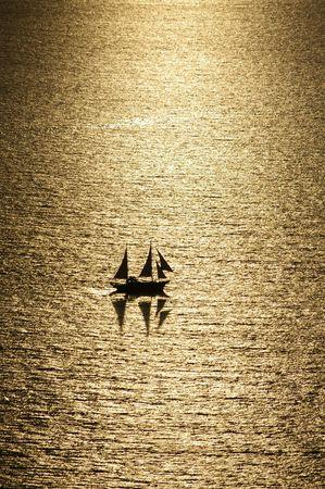A sailboat under the sunshine photo