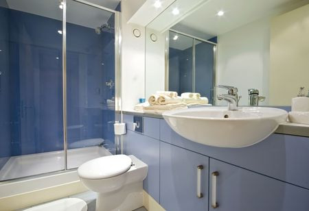 sliding door: modern blue bathroom with shower cabin Stock Photo