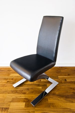 designer chair: leather designer chair of unusual shape Stock Photo