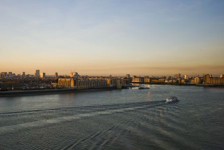 sunset over river thames with a tourist cruise boat photo