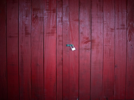 Red wooden door with a lock block  photo